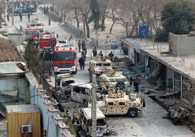Afghan security forces inspect the site of a blast in Jalalabad, Afghanistan