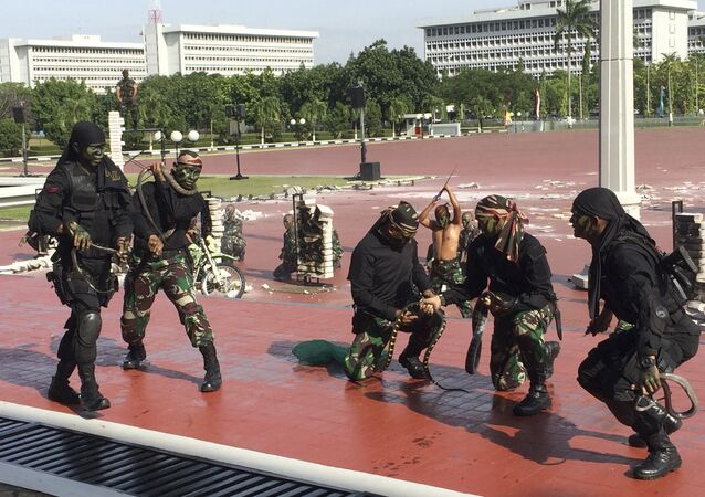 Indonesian special forces demonstrate snake-handling Wednesday, Jan. 24, 2018, for U.S. Defense Secretary Jim Mattis in Jakarta, Indonesia.