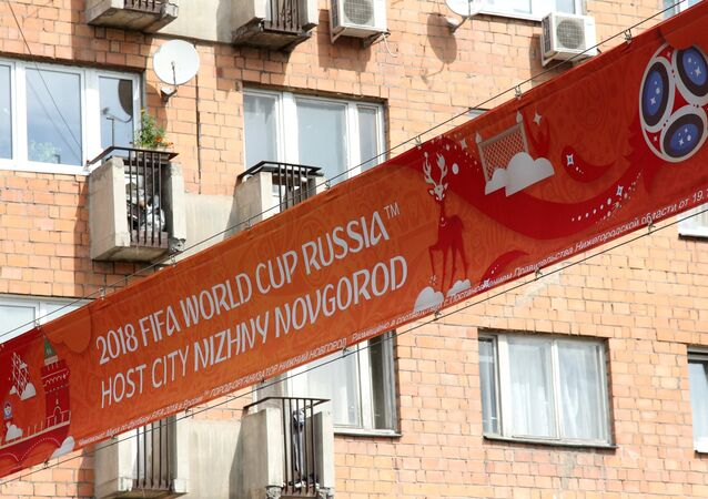 A poster with 2018 FIFA World Cup emblems overhanging a road in Nizhny Novgorod