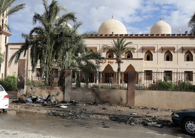 Damaged mosque walls are seen near the site of twin car bombs in Benghazi, Libya (File)