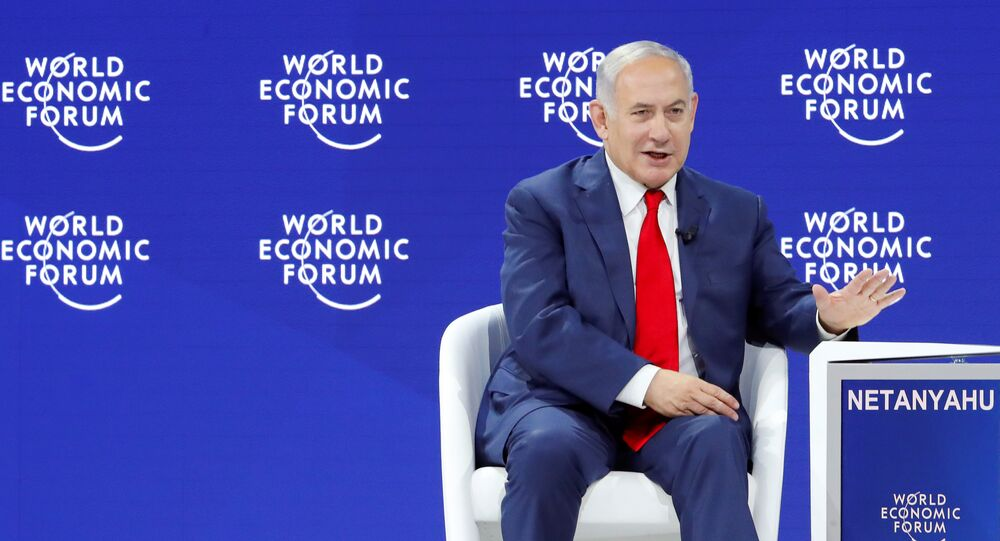 Israel's Prime Minister Benjamin Netanyahu gestures as he speaks the World Economic Forum (WEF) annual meeting in Davos, Switzerland