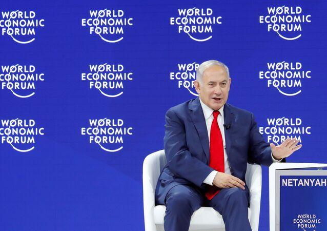Israel's Prime Minister Benjamin Netanyahu gestures as he speaks the World Economic Forum (WEF) annual meeting in Davos, Switzerland