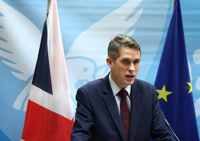 British Defence Secretary Gavin Williamson speaks to the media during a news conference in Nicosia