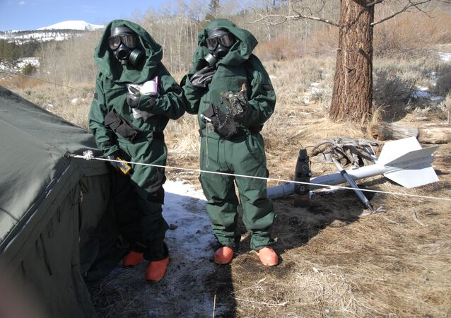 California National Guard troops in hazmat suits.
