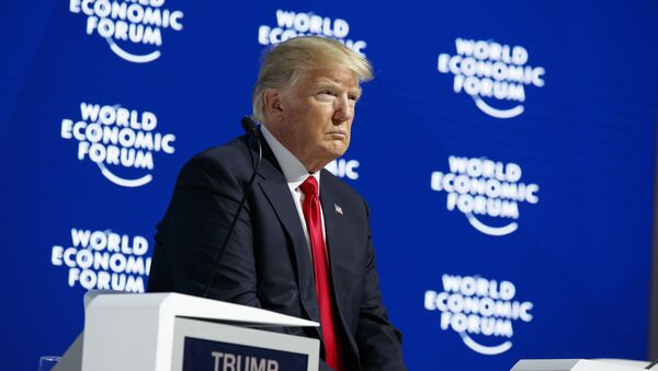 President Donald Trump listens as he is introduced to deliver a speech to the World Economic Forum, Friday, Jan. 26, 2018, in Davos - Sputnik International