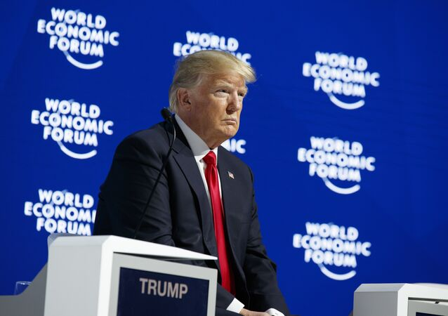 President Donald Trump listens as he is introduced to deliver a speech to the World Economic Forum, Friday, Jan. 26, 2018, in Davos