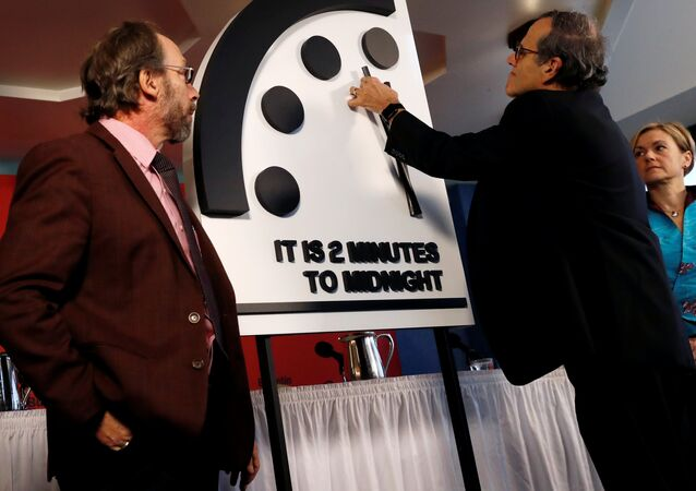 Members of the Bulletin of the Atomic Scientists, (L-R), Lawrence Krauss, Robert Rosner and Sharon Squassoni move the 'Doomsday Clock' hands to two minutes until midnight at a news conference in Washington, U.S. January 25, 2018