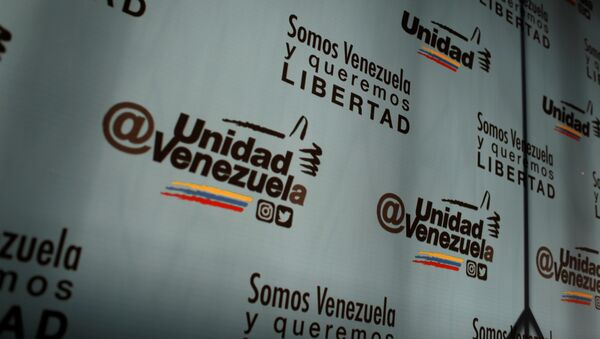 The logo of the Venezuelan coalition of opposition parties (MUD) is seen during a news conference in Caracas, Venezuela January 26, 2018 - Sputnik International