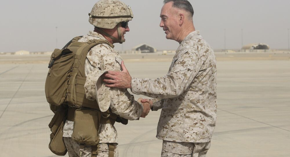 Brig. Gen. Roger Turner, left, commanding general of Task Force Southwest, greets Gen. Joseph F. Dunford Jr., chairman of the Joint Chiefs of Staff, at Bastion Airfield, Afghanistan, June 28, 2017 to reaffirm Department of Defense commitment to train, advise and assist Afghan missions