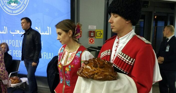 The arriving guests at Syrian National Dialogue Congress received Russia's traditional greeting.