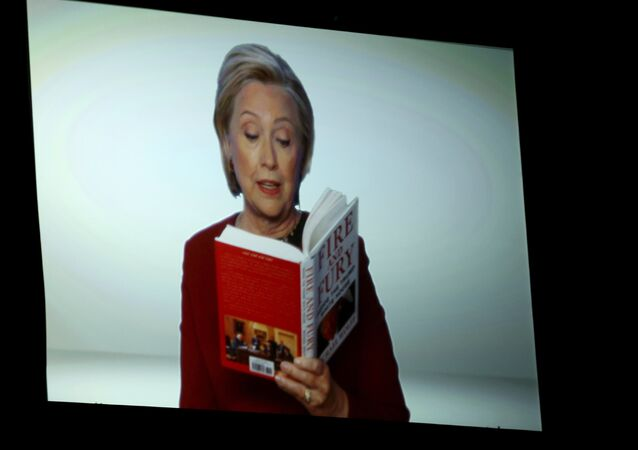 Hillary Clinton appears on screen reading an excerpt from the book Fire and Fury during a skit at the 60th annual Grammy Awards at Madison Square Garden on Sunday, Jan. 28, 2018, in New York