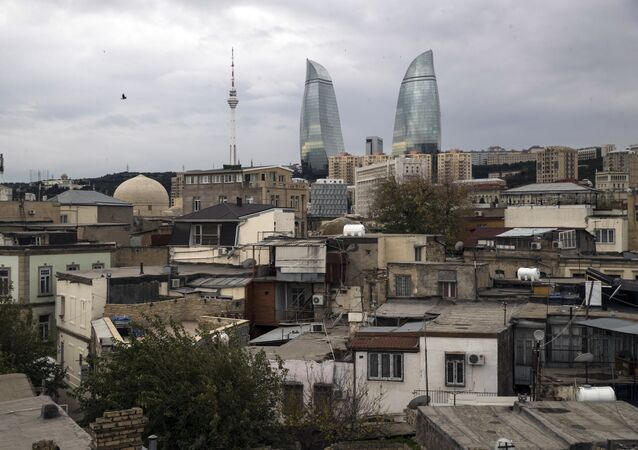 A view of the Old City with the Flame Towers skyscrapers in background in Baku, Azerbaijan, Wednesday, Nov. 23, 2017