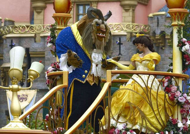 Disney characters from the movie Beauty and the Beast, Beast and Belle, dance during a parade along Main Street at Disneyland in Anaheim, Calif. Wednesday, May 4, 2005