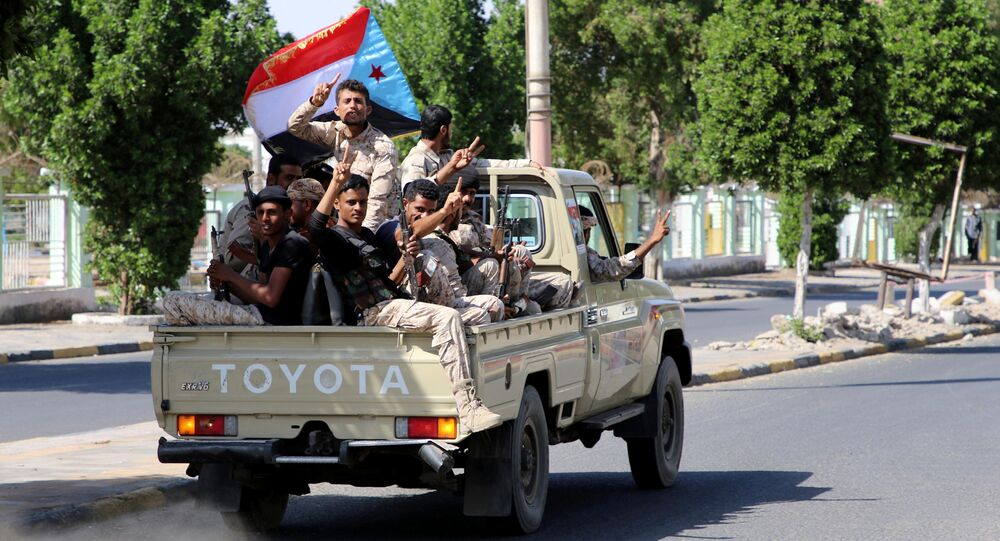 Southern Yemeni militants flash the V sign as they ride on the back of a truck in Aden, Yemen, January 29, 2018