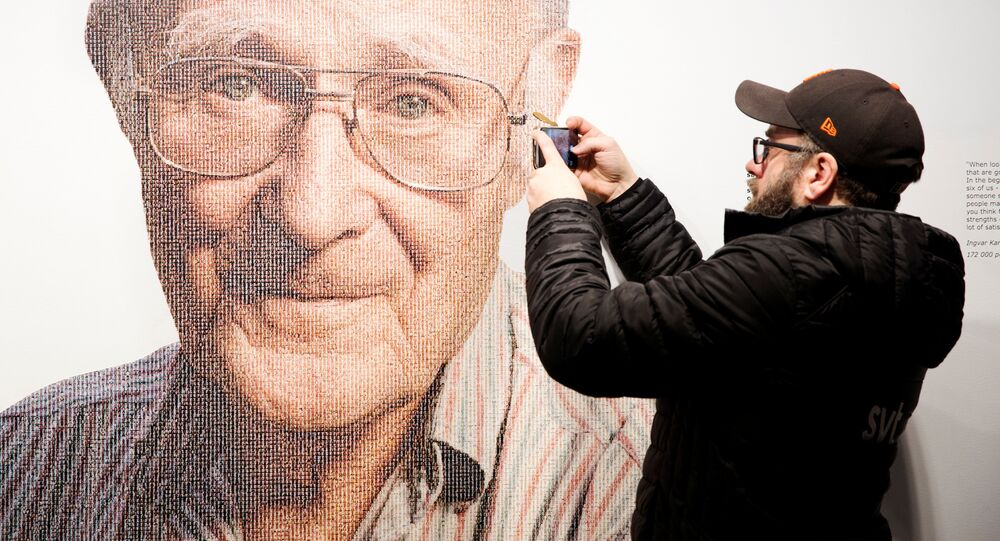 A visitor to the IKEA museum takes a mobile photo of a picture of Ingvar Kamprad, founder of Swedish multinational furniture retailer IKEA, in Almhult, Sweden, January 28, 2018