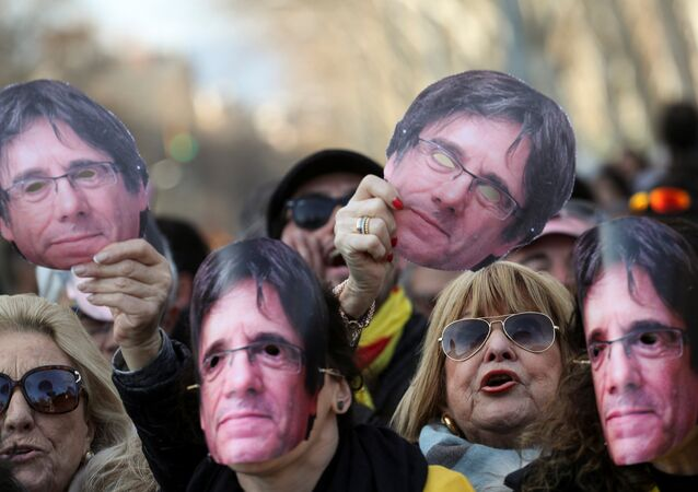 Pro-independence demonstrators wear and hold up masks depicting former regional president Carles Puigdemont during a protest outside the regional parliament in Barcelona, Spain, January 30, 2018