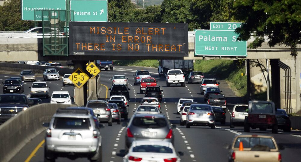 In this Jan. 13, 2018, file photo provided by Civil Beat, cars drive past a highway sign that says MISSILE ALERT ERROR THERE IS NO THREAT on the H-1 Freeway in Honolulu