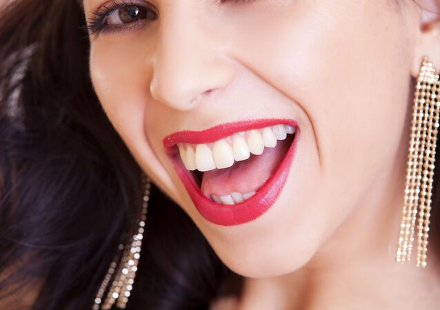 Pretty woman with nice teeth