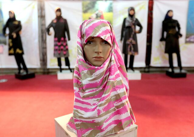 A headscarf is displayed on a mannequin at the Islamic fashion exhibit in central Tehran on December 18, 2014