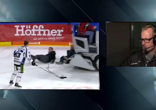 Screenshot of the dramatic moment a Zamboni backed into camera crew interviewing German hockey player Stefan Loibl.