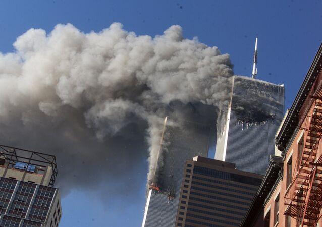 This Sept. 11, 2001 file photo shows smoke rising from the burning twin towers of the World Trade Center after hijacked planes crashed into the towers, in New York City. The U.S. government is aware of no credible or specific information that points to any terror plot tied to the anniversary of the September 2001 attacks, according to a new confidential threat assessment from the FBI and Homeland Security Department obtained by The Associated Press. (AP Photo/Richard Drew,