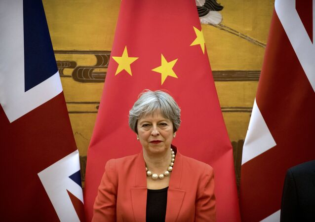 British Prime Minister Theresa May attends a signing ceremony at the Great Hall of the People in Beijing, China, January 31, 2018