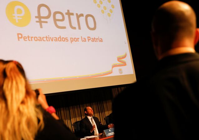 The new Venezuelan cryptocurrency the Petro logo is seen as Minister for University Education, Science and Technology Hugbel Roa talks to the media during a news conference in Caracas, Venezuela, January 31, 2018