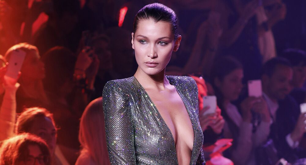 US model Bella Hadid presents a creation by Alexandre Vauthier during the 2017-2018 fall/winter Haute Couture collection in Paris on July 4, 2017