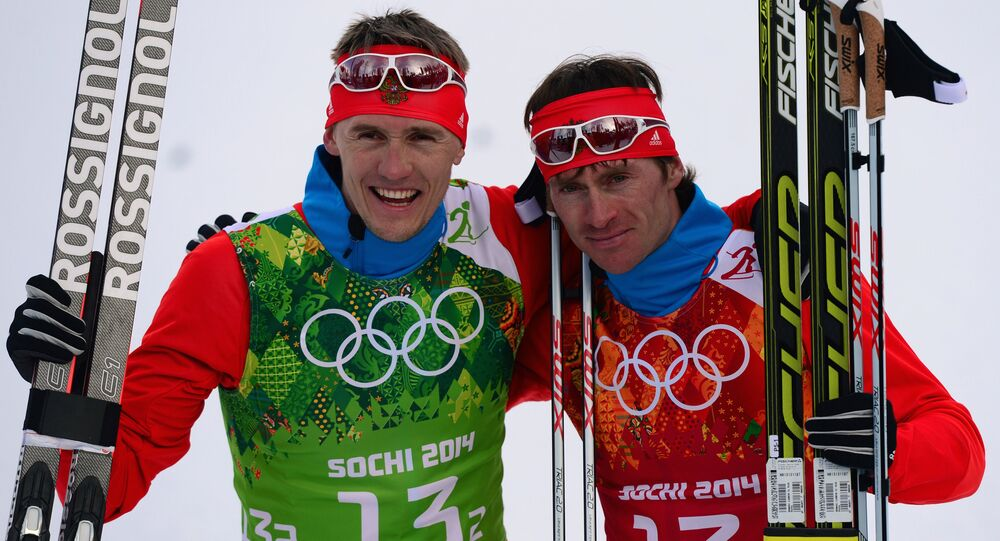 From left: Nikita Kryukov (Russia) and Maxim Vylegzhanin (Russia) at the finish of the final round of the team sprint in men's cross-country skiing at the XXII Olympic Winter Games in Sochi