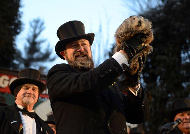 Groundhog co-handler A.J. Derume holds Punxsutawney Phil at Gobbler's Knob on the 132nd Groundhog Day in Punxsutawney, Pennsylvania, U.S. February 2, 2018