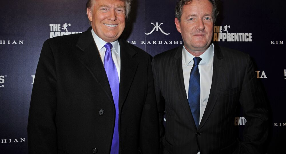 Donald Trump, left, and Piers Morgan arrive for the Perfumania party celebrating the appearance of Kim Kardashian on the reality show The Apprentice, Wednesday, 10 November 2010, in New York.