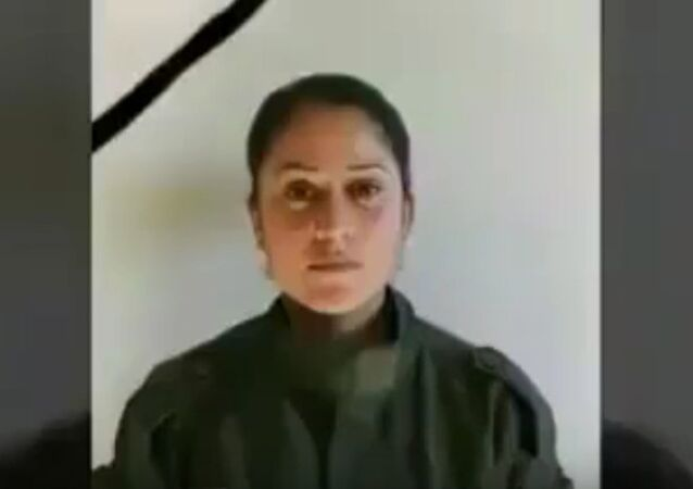 Kurdish YPG soldier Barin Kobani, formerly assigned to the Women's Protection Units. Video files of her badly-mutilated body were posted online. Turkish-backed militants invading Syria are accused of committing atrocities against foes on the Syria/Turkey border.