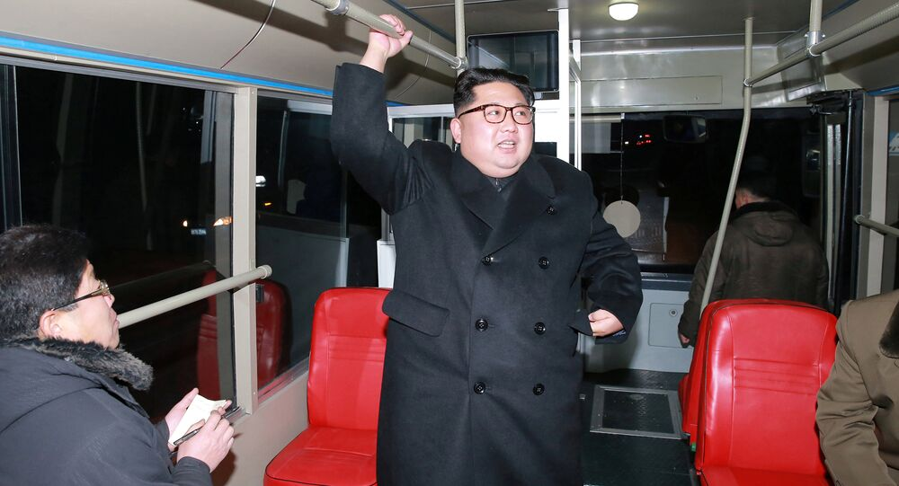 North Korean leader Kim Jong Un attends the trial of a trackless tramway, in this undated photo released by North Korea's Korean Central News Agency (KCNA) in Pyongyang February 4, 2018