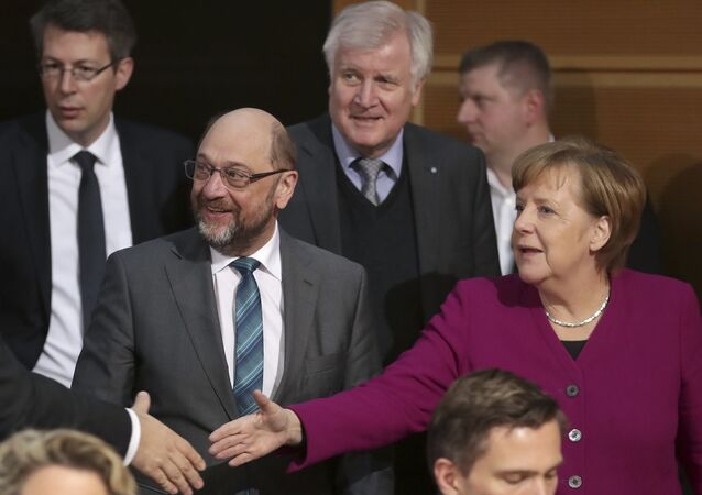 Martin Schulz, chairman of the German Social Democratic Party (SPD), front left, German Chancellor and chairwomen of the German Christian Democratic Union (CDU), Angela Merkel, front right, and Horst Seehofer, rear center, chairman of the Christian Social Union (CSU), arrive for coalition negotiations on a new German government between the Christian Unions bloc and the Social Democratic Party (SPD) in Berlin, Germany, Friday, Feb. 2, 2018.