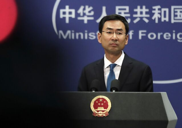 Chinese Foreign Ministry spokesman Geng Shuang pauses during a daily briefing at the Ministry of Foreign Affairs office in Beijing, Monday, Sept. 4, 2017