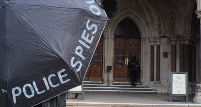 Inquiry Participant Enters Royal Court of Justice, London