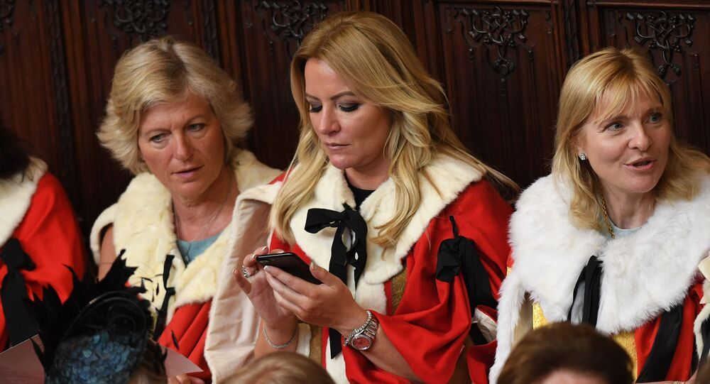 Baroness Michelle Mone (C) waits for the start of the State Opening of Parliament in the Houses of Parliament in London on June 21, 2017