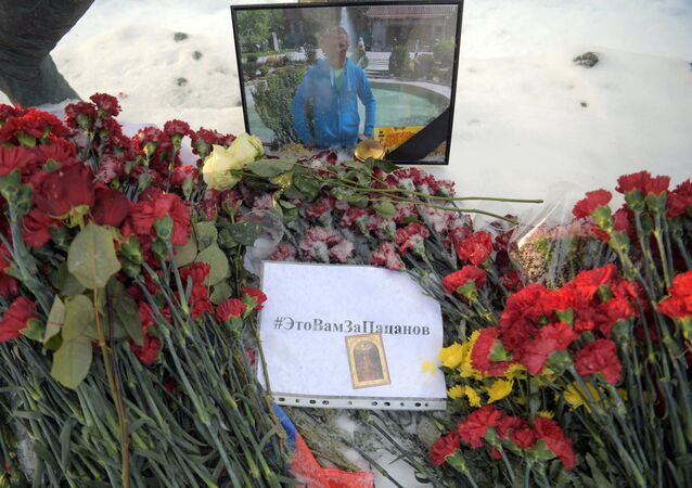 Flowers in memory of killed pilot Roman Filipov at Russian Defense Ministry