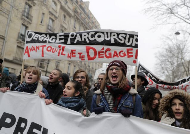 High school students hold banners during a demonstration against a French government proposed reform of university applications and a project to reform the French baccalaureate high school exit exam, on February 6, 2018, in Paris