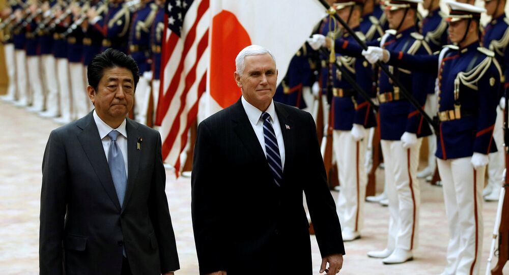 U.S. Vice President Mike Pence and Japan's Prime Minister Shinzo Abe review an honor guard before their meeting at Abe's official residence in Tokyo, Japan, February 7, 2018