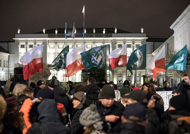 Supporters of the far-right National Radical Camp (ONR) gather in support of the Holocaust bill in front of the Presidential Palace in Warsaw, February 5, 2018