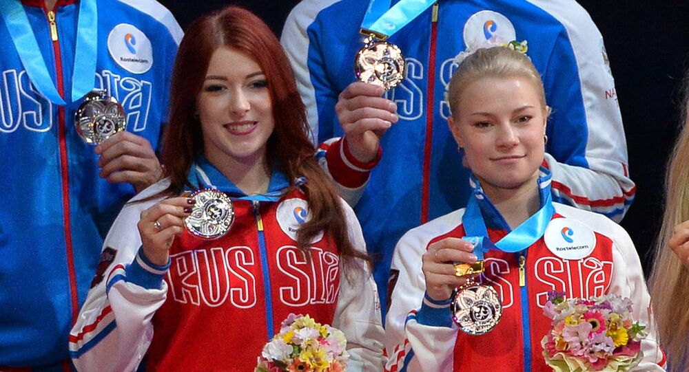 Yevgeniya Tarasova (right) and Yekaterina Bobrova during the award ceremony at the 2017 World Team Trophy in Figure Skating in Tokyo. (File)