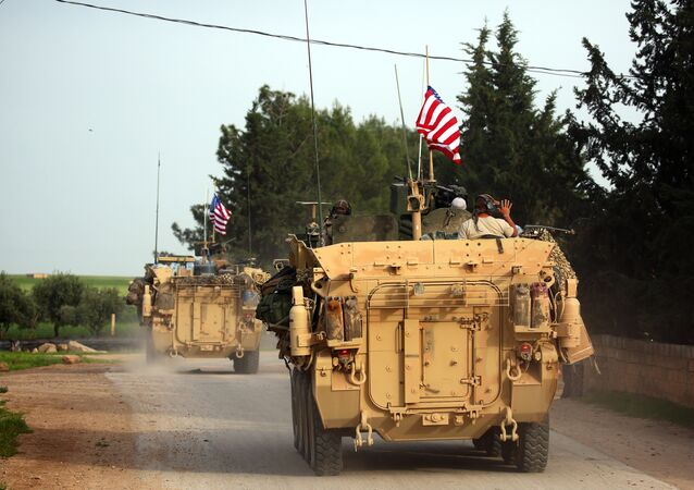 US forces, accompanied by Kurdish People's Protection Units (YPG) fighters, drive their armoured vehicles near the northern Syrian village of Darbasiyah, on the border with Turkey on April 28, 2017. (File)