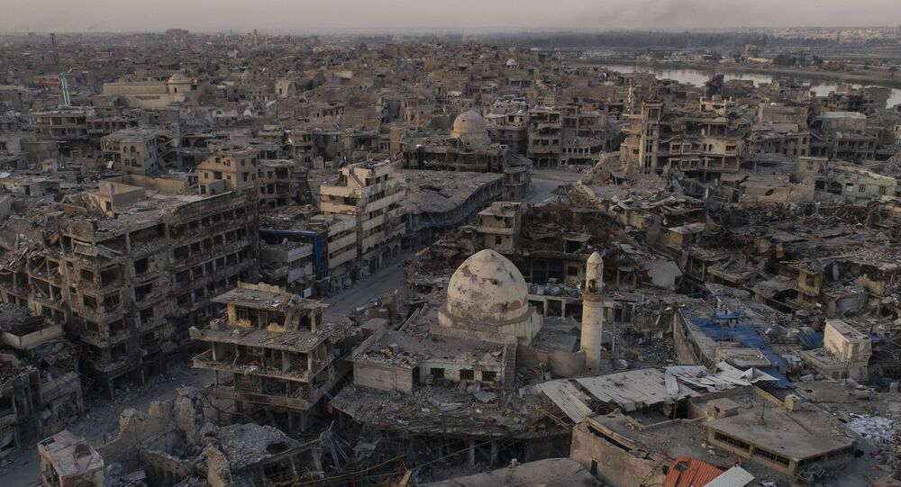 In this Nov. 15, 2017 photo, aerial view of destroyed building and shops in the Old City of Mosul, Iraq