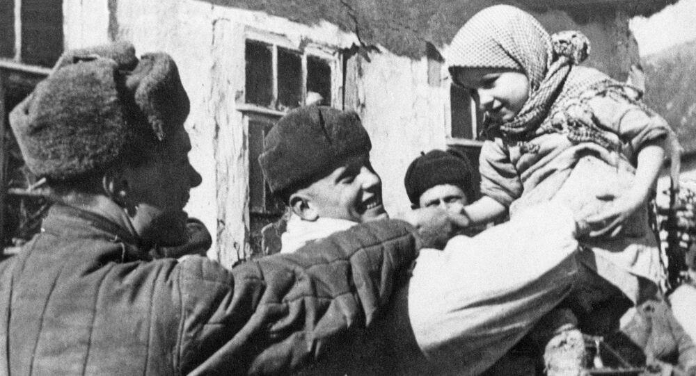 Red Army soldiers and residents of village they liberated during the 1941-1945 Great Patriotic War