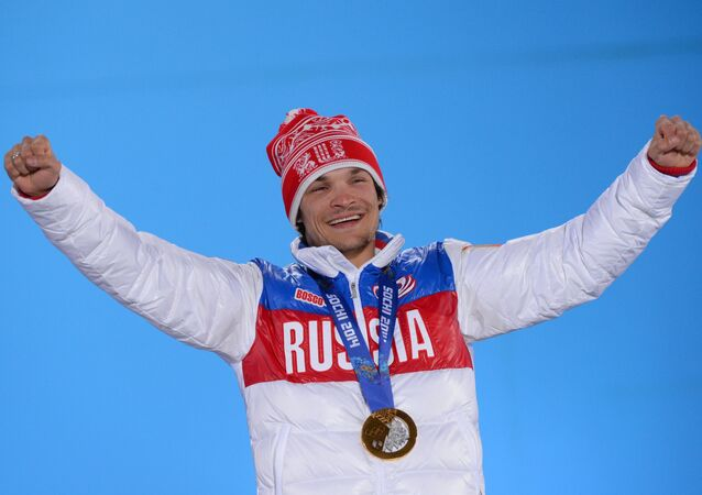 Vic Wild (Russia), winner of the gold medal in the men's parallel giant slalom at the XXII Olympic Winter Games in Sochi, during the medal ceremony. (File)