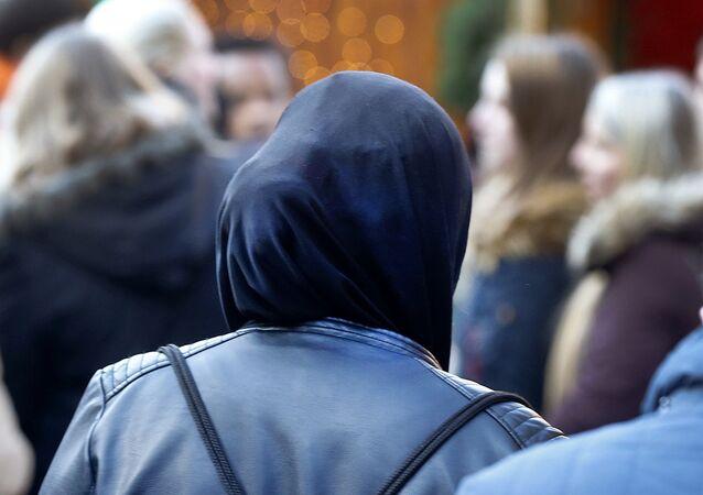 A Muslim woman walks over the Christmas market in Frankfurt, Germany