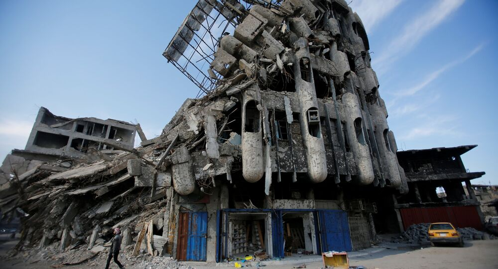 Destroyed building from previous clashes are seen in Mosul, Iraq