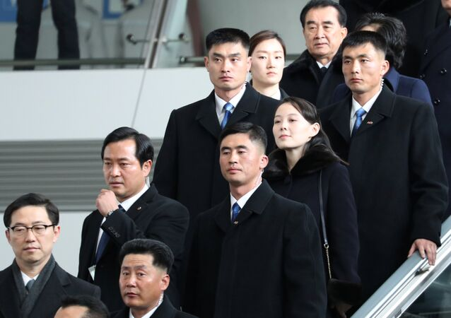 Kim Yo Jong, the younger sister of North Korean leader Kim Jong Un, is escorted by South Korean security guards at the Incheon International Airport, in Incheon, South Korea February 9, 2018