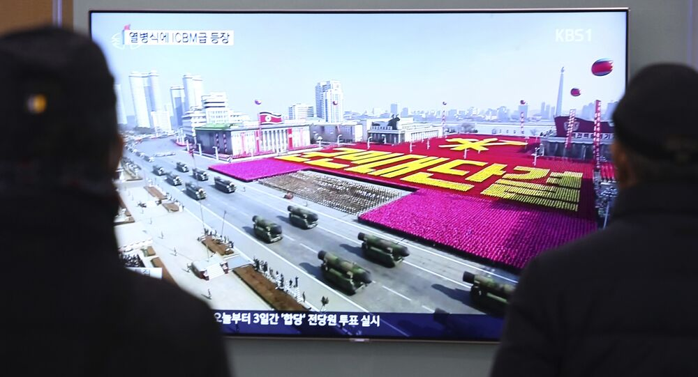 People watch a TV showing North Korea's missiles during a military parade in Pyongyang, North Korea, at Seoul Railway Station in Seoul, South Korea, Thursday, Feb. 8, 2018